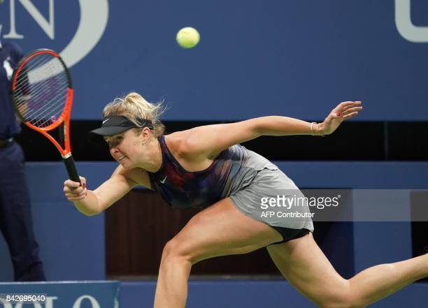 Elina Svitolina of the Ukraine hits a return to Madison Keys of the US during their fourth round 2017 US Open Women's Singles match at the USTA...
