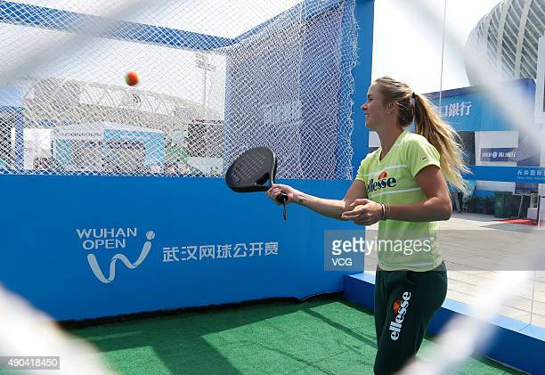Elina Svitolina of the Ukraine meets fans during day two of the 2015 Wuhan Open at Optics Vally International Tennis Center on September 28 2015 in...