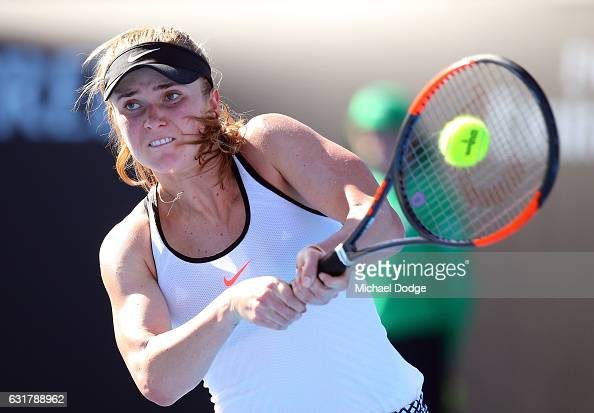 Elina Svitolina of the Ukraine plays a backhand during her first round match against Galina Voskoboeva of Kazikstan on day one of the 2017 Australian...