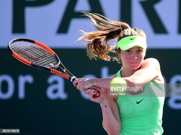 Elina Svitolina of the Ukraine plays a backhand in her match against Daria Gavrilova of Australia during the BNP Paribas Open at Indian Wells Tennis...