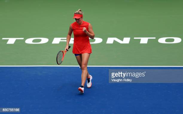 Elina Svitolina of Ukraine celebrates a point against Garbine Muguruza of Spain during a quarterfinal match on Day 8 of the Rogers Cup at Aviva...