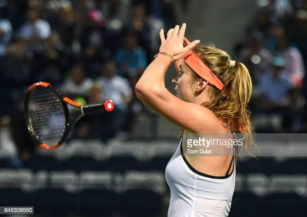 Elina Svitolina of Ukraine celebrates winning the final match against Caroline Woznacki of Denmark on day seven of the WTA Dubai Duty Free Tennis...
