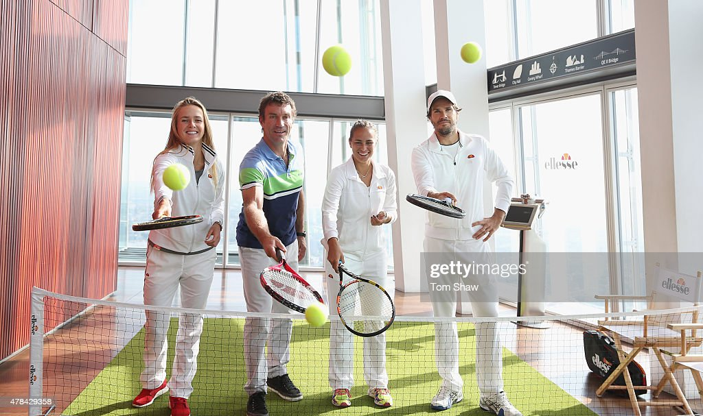 <a gi-track='captionPersonalityLinkClicked' href=/galleries/search?phrase=Elina+Svitolina&family=editorial&specificpeople=7026504 ng-click='$event.stopPropagation()'>Elina Svitolina</a> of Ukraine, Former Wimbledon Champion <a gi-track='captionPersonalityLinkClicked' href=/galleries/search?phrase=Pat+Cash&family=editorial&specificpeople=208695 ng-click='$event.stopPropagation()'>Pat Cash</a>, <a gi-track='captionPersonalityLinkClicked' href=/galleries/search?phrase=Monica+Puig&family=editorial&specificpeople=6672407 ng-click='$event.stopPropagation()'>Monica Puig</a> of Puerto Rico and <a gi-track='captionPersonalityLinkClicked' href=/galleries/search?phrase=Tommy+Haas&family=editorial&specificpeople=171956 ng-click='$event.stopPropagation()'>Tommy Haas</a> of Germany play tennis during an ellesse photo call at The View from The Shard on June 25, 2015 in London, England. ellesse created an Astroturf tennis court 776ft (236.5 metres) up in the air on Level 69 of The Shard, which is the tallest building in Western Europe.