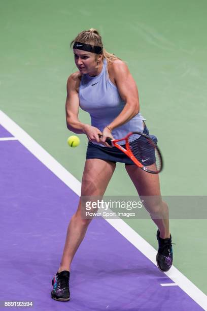 Elina Svitolina of Ukraine hits a shot in her singles match against Simona Halep of Romania during the BNP Paribas WTA Finals Singapore presented by...