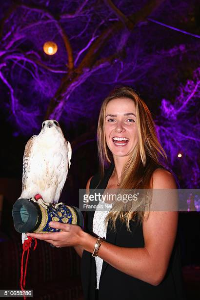 Elina Svitolina of Ukraine holds a falcon at the players party during day two of the WTA Dubai Duty Free Tennis Championship at the Dubai Duty Free...