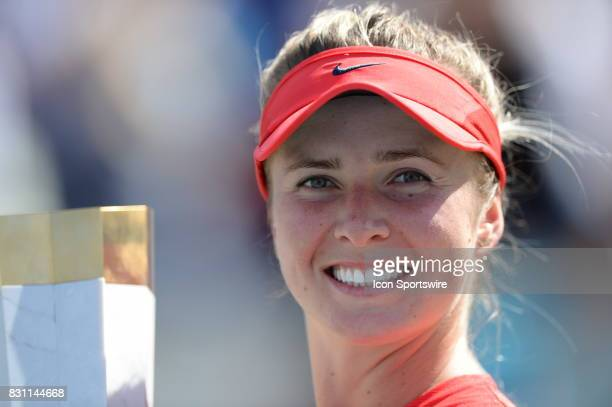 Elina Svitolina of Ukraine holds the Rogers Cup trophy after winning the 2017 Rogers Cup tennis tournament final on August 13 at Aviva Centre in...