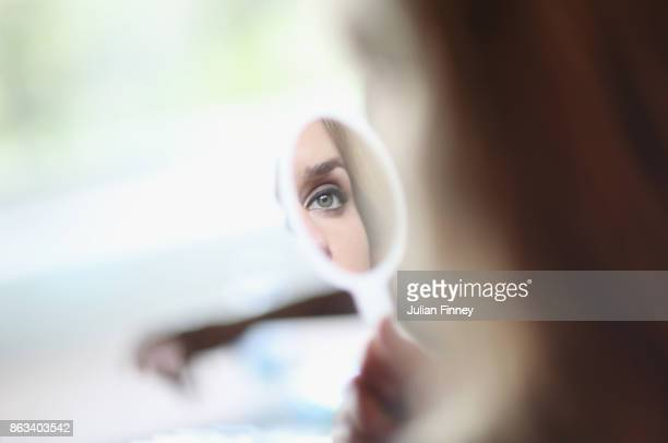 Elina Svitolina of Ukraine looks in the mirror as she attends the Style suite prior to the Official Draw Ceremony and Gala of the BNP Paribas WTA...