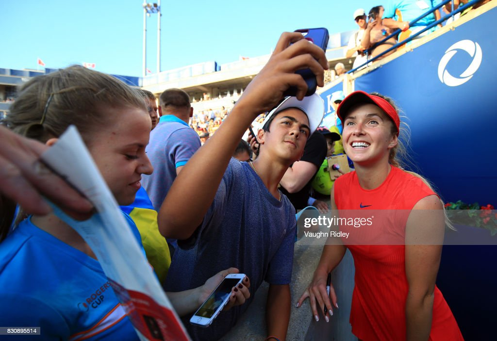 Elina Svitolina of Ukraine meets fans following her semifinal victory over Simona Halep of Romania on Day 8 of the Rogers Cup at Aviva Centre on August 12, 2017 in Toronto, Canada.