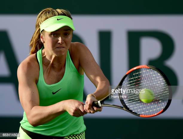 Elina Svitolina of Ukraine plays a backhand in her loss to Garbine Muguruza of Spain after her win during the BNP Paribas Open at Indian Wells Tennis...