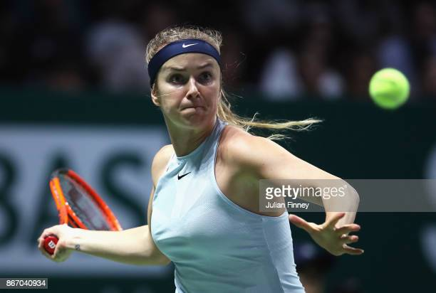 Elina Svitolina of Ukraine plays a forehand in her singles match against Simona Halep of Romania during day 6 of the BNP Paribas WTA Finals Singapore...
