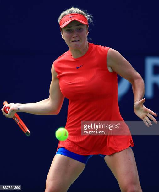 Elina Svitolina of Ukraine plays a shot against Garbine Muguruza of Spain during a quarterfinal match on Day 8 of the Rogers Cup at Aviva Centre on...