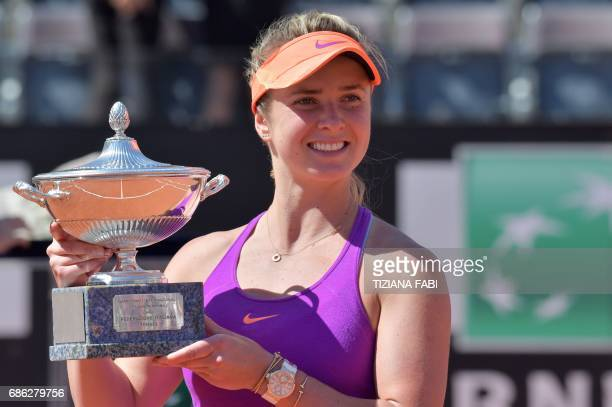 Elina Svitolina of Ukraine poses with the trophy after winning the WTA Tennis Open final against Simona Halep of Romania on May 21 2017 at the Foro...