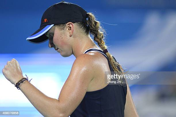 Elina Svitolina of Ukraine reacts after winning her match against Angelique Kerber of Germany day five of 2014 Dongfeng Motor Wuhan Open at Optics...