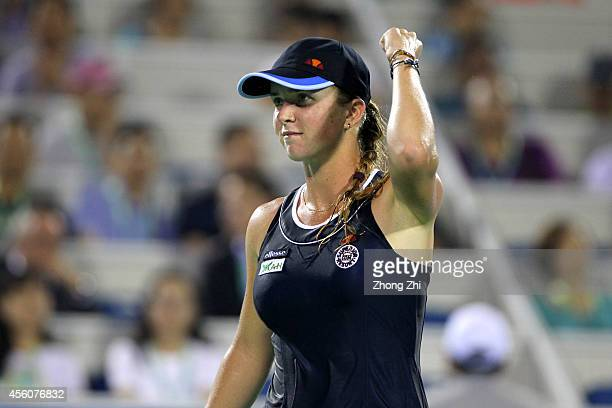 Elina Svitolina of Ukraine reacts during her match against Angelique Kerber of Germany day five of 2014 Dongfeng Motor Wuhan Open at Optics Valley...