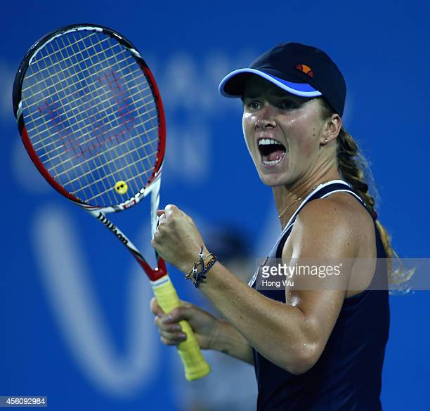 Elina Svitolina of Ukraine reacts during her match against Angelique Kerber of Germany on day five of 2014 Dongfeng Motor Wuhan Open at Optics Valley...