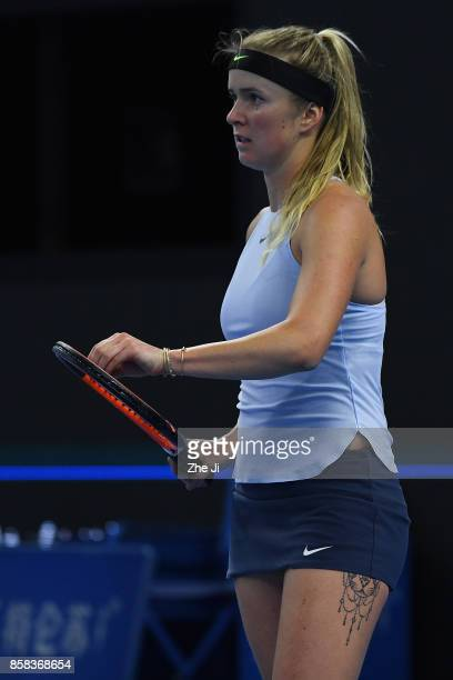 Elina Svitolina of Ukraine reacts during the Women's singles Quarterfinals match against Caroline Garcia of France on day seven of 2017 China Open at...