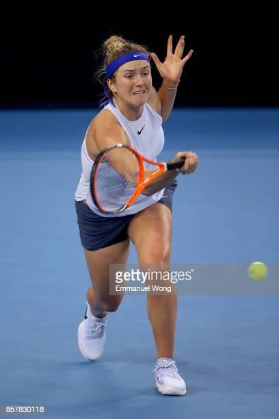 Elina Svitolina of Ukraine returns a shot against Elena Vesnina of Russia during the Women's singles thrid round match on day six of the 2017 China...