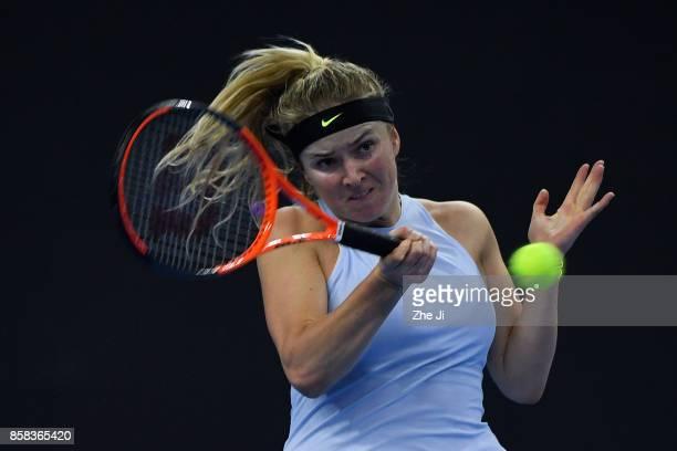 Elina Svitolina of Ukraine returns a shot during the Women's singles Quarterfinals match against Caroline Garcia of France on day seven of 2017 China...