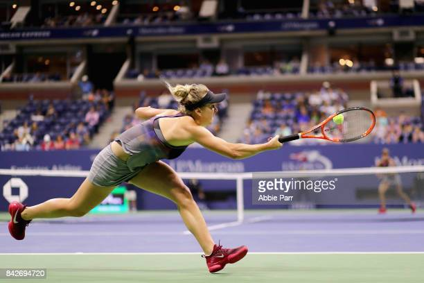 Elina Svitolina of Ukraine returns a shot to Madison Keys of the United States during their women's singles fourth round match on Day Eight of the...