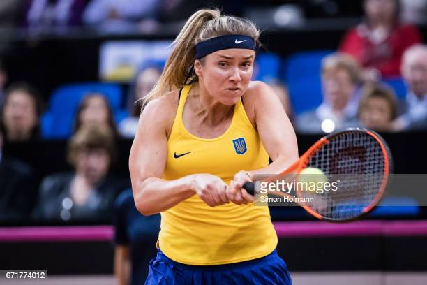 Elina Svitolina of Ukraine returns the ball against Angelique Kerber of Germany during the FedCup World Group PlayOff match between Germany and...