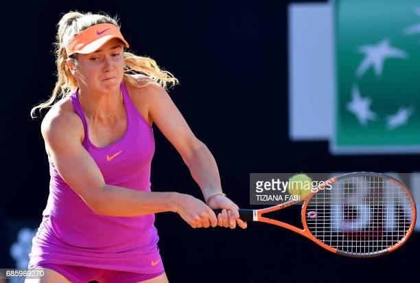 Elina Svitolina of Ukraine returns the ball to Garbine Muguruza of Spain during their semifinal at the WTA Tennis Open tournament at the Foro Italico...