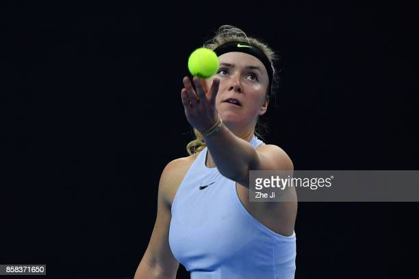 Elina Svitolina of Ukraine serves against during the Women's singles Quarterfinals match against Caroline Garcia of France on day seven of 2017 China...