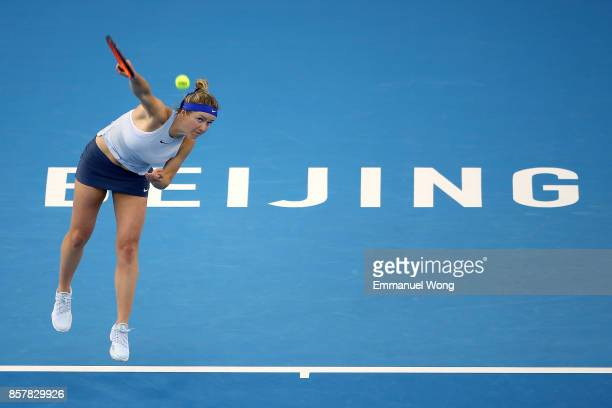 Elina Svitolina of Ukraine serves against Elena Vesnina of Russia during the Women's singles thrid round match on day six of the 2017 China Open at...