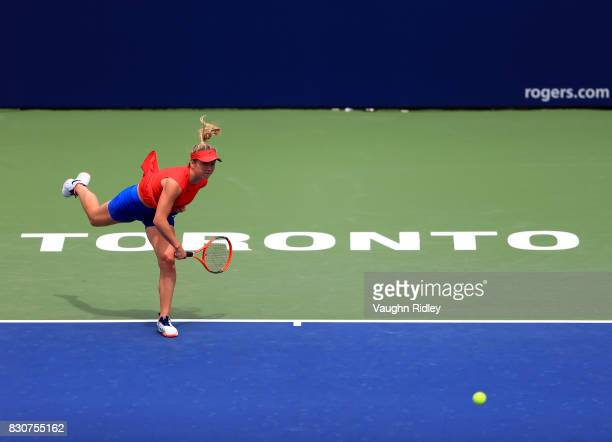 Elina Svitolina of Ukraine serves against Garbine Muguruza of Spain during a quarterfinal match on Day 8 of the Rogers Cup at Aviva Centre on August...