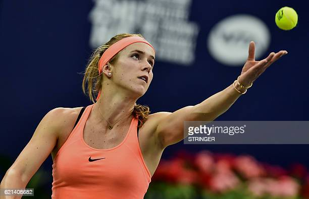 Elina Svitolina of Ukraine serves against Petra Kvitova of the Czech Republic during their singles final match at the WTA Elite Trophy in Zhuhai...