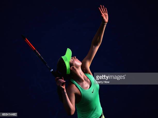 Elina Svitolina of Ukraine serves in her loss to Garbine Muguruza of Spain after her win during the BNP Paribas Open at Indian Wells Tennis Garden on...