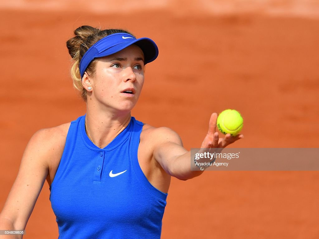 Elina Svitolina of Ukraine serves to Ana Ivanovic (not seen) of Serbia during the women's single third round match at the French Open tennis tournament at Roland Garros Stadium in Paris, France on May 28, 2016.