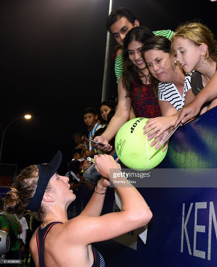Elina Svitolina of Ukraine signs autographs for fans after she defeated Eugenie Bouchard of Canada during the Singles Final of the 2016 BMW Malaysian Open at Kuala Lumpur Golf & Country Club on March 6, 2016 in Kuala Lumpur, Malaysia.