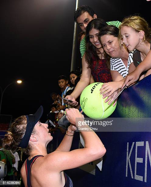 Elina Svitolina of Ukraine signs autographs for fans after she defeated Eugenie Bouchard of Canada during the Singles Final of the 2016 BMW Malaysian...