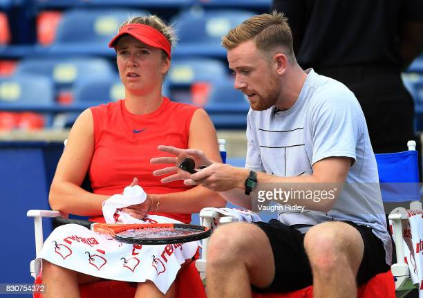 Elina Svitolina of Ukraine speaks to her coach during a quarterfinal match against Garbine Muguruza of Spain on Day 8 of the Rogers Cup at Aviva...