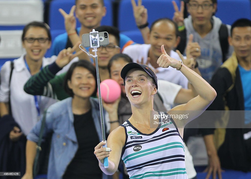 <a gi-track='captionPersonalityLinkClicked' href=/galleries/search?phrase=Elina+Svitolina&family=editorial&specificpeople=7026504 ng-click='$event.stopPropagation()'>Elina Svitolina</a> of Ukraine takes selfie with fans after winning the match against Andrea Petkovic of Germany on day 2 of Huajin Securities WTA Elite Trophy Zhuhai at Hengqin Tennis Center on November 3, 2015 in Zhuhai, China.