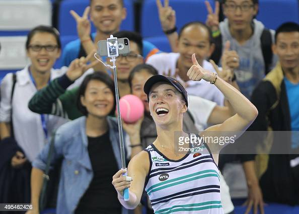 Elina Svitolina of Ukraine takes selfie with fans after winning the match against Andrea Petkovic of Germany on day 2 of Huajin Securities WTA Elite...