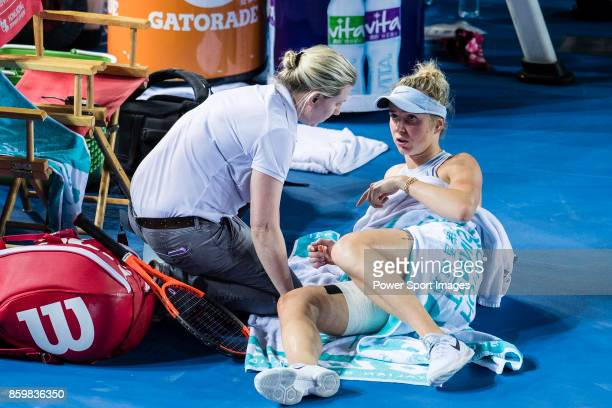 Elina Svitolina of Ukraine talks with her physiotherapist during the Prudential Hong Kong Tennis Open 2017 match between Elina Svitolina of Ukraine...