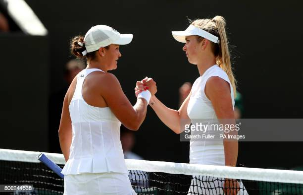 Elina Svitolina shakes hands with Ashleigh Barty after their match on day one of the Wimbledon Championships at The All England Lawn Tennis and...