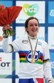 Elinor Barker of Great Britain celebrates on the podium after winning the Junior Women's Individual Time Trial on day three of the UCI Road World...