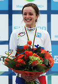 Elinor Barker of Great Britain smiles on the podium after winning the Junior Women's Individual Time Trial on day four of the UCI Road World...
