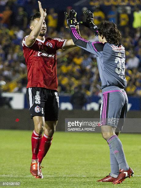 Elio Castro and goalkeeper Federico Vilar of Tijuana celebrate after scoring againstTigres during the Mexican Clausura 2016 tournament football match...