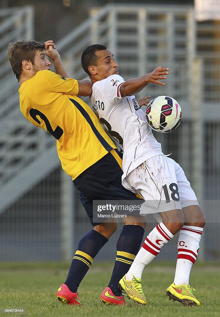 Elio De Silvestro (R) of Carpi FC competes for the ball with Stephan Ristovski (L) of Parma during the pre-season friendly match between Carpi FC and FC Parma at Stadio Sandro Cabassi on August 23, 2014 in Carpi, Italy.