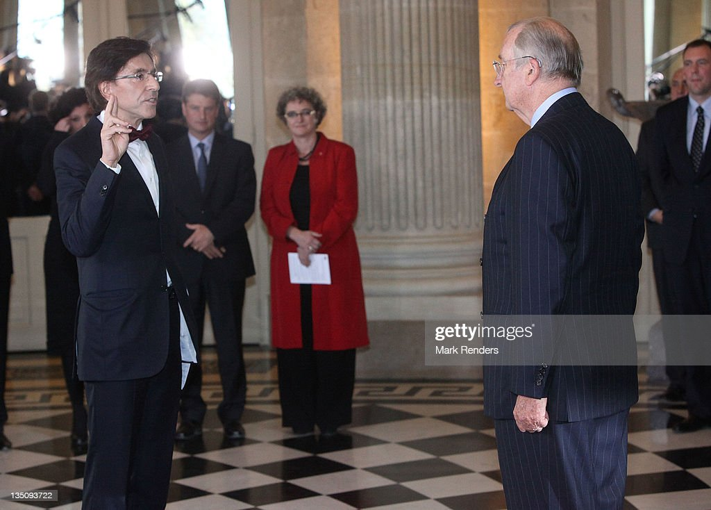 <a gi-track='captionPersonalityLinkClicked' href=/galleries/search?phrase=Elio+Di+Rupo&family=editorial&specificpeople=743705 ng-click='$event.stopPropagation()'>Elio Di Rupo</a> (L) is sworn as Belgian Prime Minister by King Albert of Belgium at Laeken Castle on December 6, 2011 in Brussels, Belgium. Socialist leader Di Rupo has been sworn in as the new head of the Belgian coalition government today after the country endured 541 days without an official leader while the parties worked out their differences and agreed on a new government.