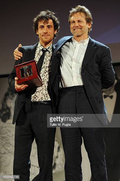 Elio Germano poses with Giulio Scarpati after receiving the award for Best Actor during the Nastri d'Argento ceremony awards on June 19 2010 in...