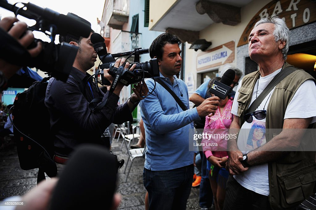 Elio Vincenzi the husband of Maria Grazia Trecarichi, one of the victims of the Costa Concordia shipwreck, talks with journalists during the last stage of refloating operation of the wrecked cruise ship Costa Concordia on July 22, 2014 in Isola del Giglio, Italy. Technicians are working to finish the refloat of the ship and aim to start towing the ship to the port of Genoa for dismantling on Wednesday, July 23.