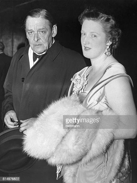 TS Eliot at first night of his new play London Mr TS Eliot arriving with his wife at the Cambridge Theatre here tonight for the first night of his...