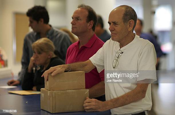 Eliot Bloom waits in a line to mail his Christmas packages at a post office December 18 2006 in Coral Gables Florida According to the United States...