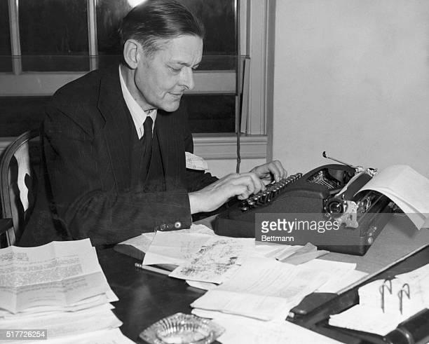 British poet inspecting manuscripts Undated photograph