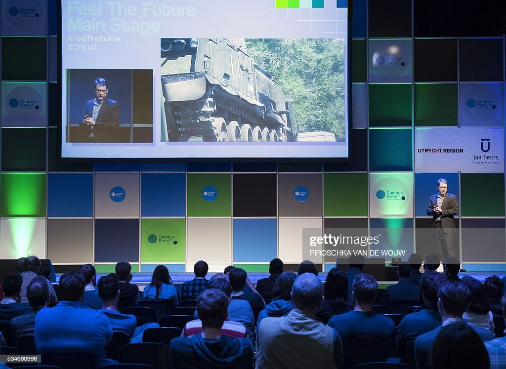 Eliot Higgins, British investigative journalist and founder of Bellingcat, for citizen journalists to investigate current events using open-source information, speaks during the world biggest techfestival Campus Party in Utrecht May 27, 2016. / AFP / ANP / Piroschka van de Wouw / Netherlands OUT