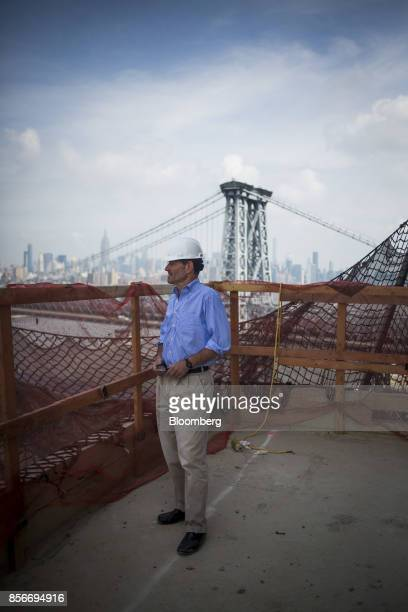 Eliot Spitzer former governor of New York stands for a photograph at the 416 Kent Avenue apartment development under construction in the Williamsburg...